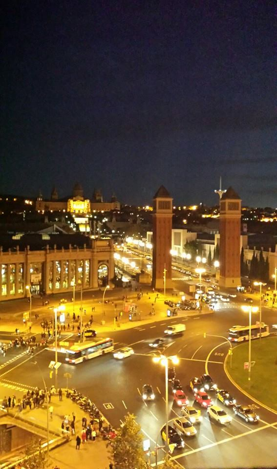 Night time view of the Plaza de Espanya and the Magic Fountain in the background from the top of Las Arenas