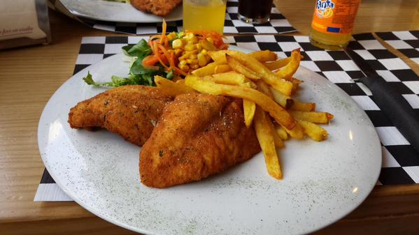 Chicken in breadcrumbs, chips and salad combination meal