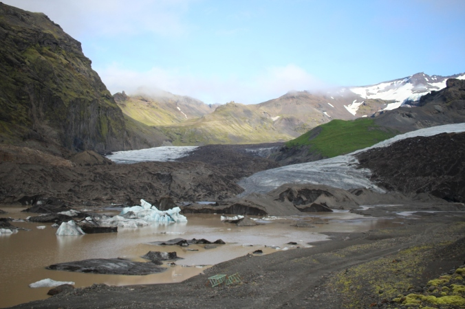 The glacial lake, moraines in the background (left) and glacier (right)